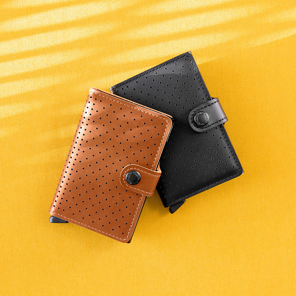 secrid miniwallet perforated black cognac lifestyle 1000