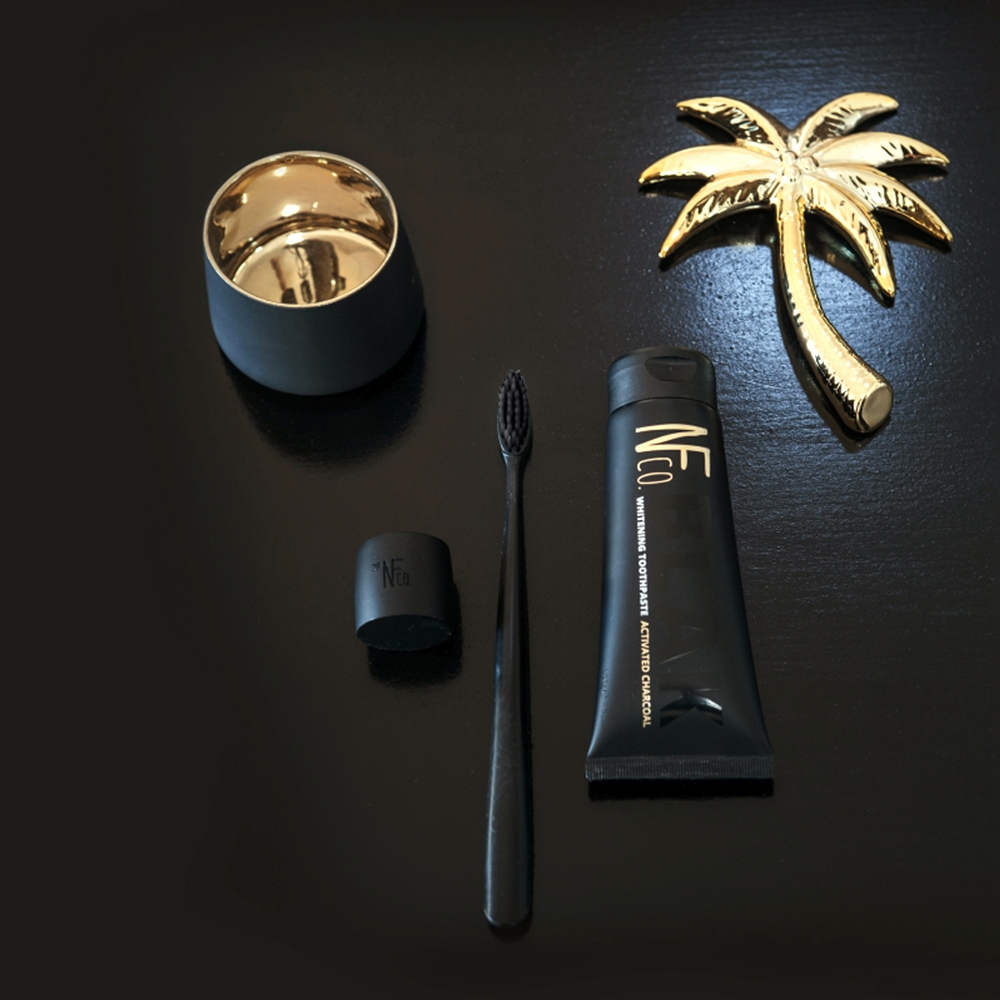 nfco toothbrush black toothpaste charcoal lifestyle 1000