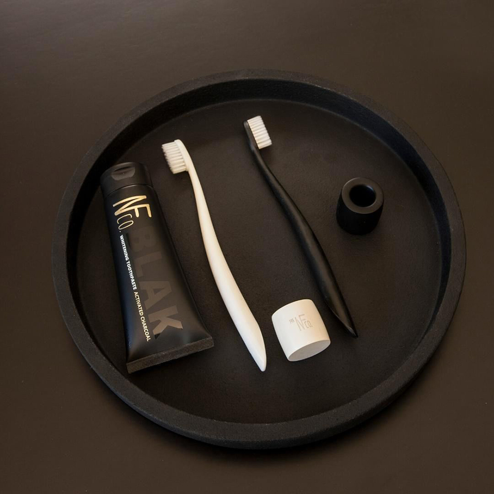 nfco black toothpaste black white toothbrush stand lifestyle 01 1000